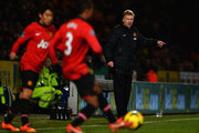 David Moyes manager of Manchester United signals as he watches Shinji Kagawa (L) and Patrice Evra of Manchester United (C) in action during the Barclays Premier League match between Norwich City and  Manchester United at Carrow Road on December 28, 2013 in Norwich, England.