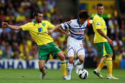 Jonny Howson of Norwich and Ji Sung Park of Queens Park Rangers challenge for the ball during the Barclays Premier League match between Norwich City and Queens Park Rangers at Carrow Road on August 25, 2012 in Norwich, England.