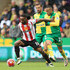 Martin Olsson Photos - Jermain Defoe of Sunderland is challenged by Martin Olsson of Norwich City during the Barclays Premier League match between Norwich City and Sunderland at Carrow Road on April 16, 2016 in Norwich, England. - Norwich City v Sunderland - Premier League