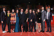 "(L-R) Giovanni Toscano, Mauro Lamantia,  Irene Vetere, Annalisa Arena, Paolo Virzi, a guest, Paolo Sassanelli, a guest, Eliana Miglio and Giulio Berruti walk the red carpet ahead of the ""Notti Magiche"" screening during the 13th Rome Film Fest at Auditorium Parco Della Musica on October 27, 2018 in Rome, Italy."