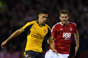 Nicklas Bendtner of Nottingham Forest closes Gabriel of Arsenal   during the EFL Cup Third Round match between Nottingham Forest and Arsenal at City Ground on September 20, 2016 in Nottingham, England.