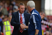 Stuart Pearce, Manager of Nottingham Forest shakes hands with Mick McCarthy, Manager of Ipswich Town during the Sky Bet Championship match between Nottingham Forest and Ipswich Town at City Ground on October 5, 2014 in Nottingham, England.