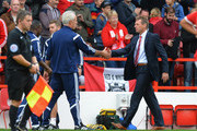 Stuart Pearce, Manager of Nottingham Forest shakes hands with Mick McCarthy, Manager of Ipswich Town at the end of the Sky Bet Championship match between Nottingham Forest and Ipswich Town at City Ground on October 5, 2014 in Nottingham, England.