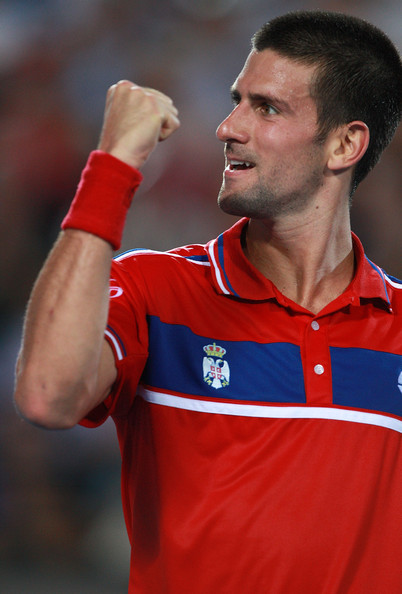 Novak Djokovic Novak Djokovic of Serbia celebrates winning a game during his singles match against Lleyton Hewitt of Australia on day four of the Hopman Cup on January 4, 2011 in Perth, Australia.