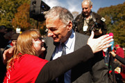 Political activist and former presidential candidate Ralph Nader gets a hug from a supporter after addressing hundreds of members of National Nurses United and their supporters during a rally in Laffayette Square across from the White House before marching to the U.S. Treasury Department November 3, 2011 in Washington, DC. In the spirit of the Occupy Wall Street movement, members of various labor unions with the AFL-CIO joined the nurses in their call to tax financial transactions on Wall Street and around the world as a way of reducing the national debt.