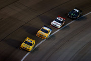 Sam Hornish Jr., driver of the #12 Alliance Truck Parts Ford, leads Alex Bowman, driver of the #99 SchoolTipLine.com Toyota, Brad Keselowski, driver of the #22 Discount Tire Ford, and Kyle Busch, driver of the #54 Monster Energy Toyota, during the NASCAR Nationwide Series O'Reilly Auto Parts 300 at Texas Motor Speedway on April 12, 2013 in Fort Worth, Texas.