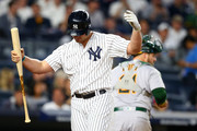 Matt Holliday #17 of the New York Yankees reacts after striking out in the sixth inning against the Oakland Athletics at Yankee Stadium on May 26, 2017 in the Bronx borough of New York City.