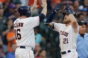 Derek Fisher #21 of the Houston Astros receives a high five from Brian McCann #16 after hitting a two-run home run in the fourth inning against the Oakland Athletics at Minute Maid Park on April 28, 2018 in Houston, Texas.