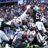 Tyrod Taylor Photos - Tyrod Taylor #5 of the Buffalo Bills leaps for a touchdown as NaVorro Bowman #53 of the Oakland Raiders attempts to stop him during the fourth quarter of an NFL game on October 29, 2017 at New Era Field in Orchard Park, New York. - Oakland Raiders vBuffalo Bills