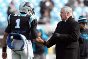 Owner of the Carolina Panthers, Jerry Richardson, talks to quarterback Cam Newton #1 before their game against the Oakland Raiders at Bank of America Stadium on December 23, 2012 in Charlotte, North Carolina.
