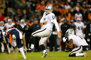 Kicker Sebastian Janikowski #11 of the Oakland Raiders watches a missed field goal attempt against the Denver Broncos during a game at Sports Authority Field at Mile High on December 13, 2015 in Denver, Colorado.