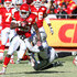 Jamaal Charles Photos - Running back Jamaal Charles #25 of the Kansas City Chiefs is tackled by linebacker Rolando McClain #55 of the Oakland Raiders in a game at Arrowhead Stadium on January 2, 2011 in Kansas City, Missouri. - Oakland Raiders v Kansas City Chiefs