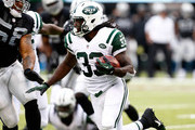 Chris Ivory #33 of the New York Jets rushes the ball against the Oakland Raiders in the first quarter at MetLife Stadium on September 7, 2014 in East Rutherford, New Jersey.