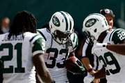 Chris Ivory #33 of the New York Jets celebrates his fourth quarter touchdown against the Oakland Raiders with  teammates Bilal Powell #29 and  Chris Johnson #21 at MetLife Stadium on September 7, 2014 in East Rutherford, New Jersey.