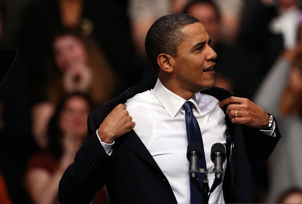 U.S. President Barack Obama removes his jacket before speaking on health care reform at George Mason University March 19, 2010 in Fairfax, Virginia. Obama is making a last minute appeal for support of his proposed health care legislation as the U.S. House of Representatives is expected to vote on the legislation as early as Sunday afternoon March 21.