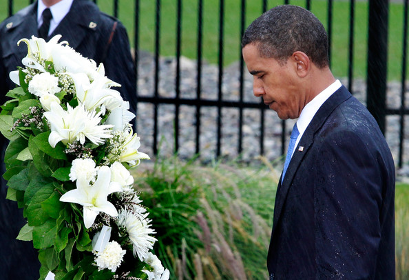 U.S. President Barack Obama bows his head after laying a flower wreath during a 9/11 Rememberance Ceremony at the Pentagon September 11, 2009 in Arlington, Virginia. Obama joined staff and family members at the Pentagon to comemorate the eighth anniversary of the September 11 attacks.