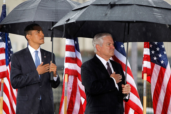 U.S. President Barack Obama (L) and Defense Secretary Robert Gates put hands over their hearts during the National Anthem at a 9/11 Rememberance Ceremony at the Pentagon September 11, 2009 in Arlington, Virginia. Obama and Gates joined staff and family members at the Pentagon to comemorate the eighth anniversary of the September 11 attacks.