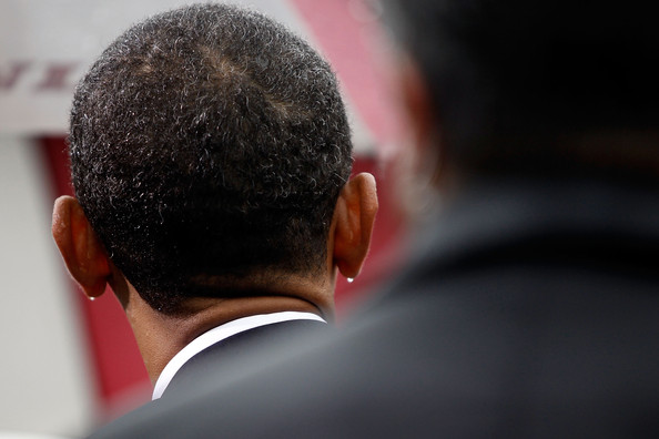 Drops of rain cling to the earlobes of U.S. President Barack Obama during a 9/11 Rememberance Ceremony at the Pentagon September 11, 2009 in Arlington, Virginia. Obama joined staff and family members at the Pentagon to comemorate the eighth anniversary of the September 11 attacks.