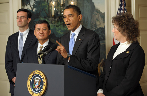 (AFP OUT) U.S. President Barack Obama (2R) makes a statement on the SAVE (Securing Americans Value and Efficiency) program with Office of Management and Budget Director Peter R. Orszag (L), Secretary of Veterans Affairs Gen. Eric Shinseki (2L) and SAVE Award winner Nancy Fichtner of Colorado in the Diplomatic Reception Room of the White House on December 21, 2009 in Washington, DC. The award is given to Federal employees who submit ideas for saving the government money. He also applauded the Senate's vote to end a Republican filibuster aimed at blocking health care reform.