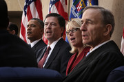 (L-R) U.S. President Barack Obama, FBI Director James Comey, his wife Patrice, Judge John Walker listen to the song God Bless America during a ceremonial swearing-in at the FBI Headquarters October 28, 2013 in Washington, DC. Comey was officially sworn in as director of FBI on September 4 to succeed Robert Mueller who had served as director for 12 years.