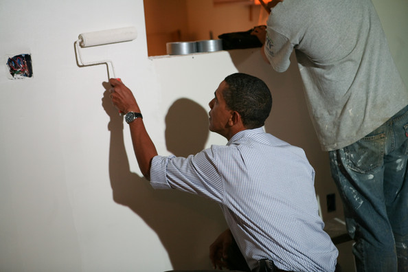 (AFP OUT) U.S. President Barack Obama paints in a house being built by Habitat for Humanity on September 11, 2009 in Washington, DC. In observance of the eighth anniversary of the 9/11 terrorist attack, the Obamas participated in the community service activity after attending a moment of silence for 9/11 victims on the South Lawn of the White House.