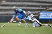 Kevin Drew #19 of the Charlotte Hounds beats Greg Puskuldjian #94 of the Ohio Machine to a ground ball during their game at American Legion Memorial Stadium on June 5, 2015 in Charlotte, North Carolina.