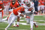 Braxton Miller #5 of the Ohio State Buckeyes is hit by Zane Petty #21 of the Illinois Fighting Illini after running for a first down at Memorial Stadium on November 16, 2013 in Champaign, Illinois.