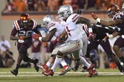 Quarterback Braxton Miller #1 of the Ohio State Buckeyes rushes for a long touchdown against the Virginia Tech Hokies in the second half at Lane Stadium on September 7, 2015 in Blacksburg, Virginia. Ohio State defeated Virginia Tech 42-24.
