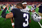 Shawn Robinson #3 of the TCU Horned Frogs hugs Dwayne Haskins #7 of the Ohio State Buckeyes after the Ohio State Buckeyes beat the TCU Horned Frogs 40-28 during The AdvoCare Showdown at AT&T Stadium on September 15, 2018 in Arlington, Texas.