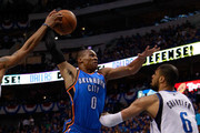 Russell Westbrook #0 of the Oklahoma City Thunder goes up for a dunk as Shawn Marion #0 of the Dallas Mavericks attempts to block the dunk as Westbrook crashes into Tyson Chandler #6 of the Mavericks in Game Five of the Western Conference Finals during the 2011 NBA Playoffs at American Airlines Center on May 25, 2011 in Dallas, Texas. NOTE TO USER: User expressly acknowledges and agrees that, by downloading and or using this photograph, User is consenting to the terms and conditions of the Getty Images License Agreement.