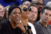 Rapper Jay-Z and wife Beyonce sits courtside during an NBA basketball game between the Oklahoma City Thunder and Golden State Warriors at ORACLE Arena on February 6, 2016 in Oakland, California. NOTE TO USER: User expressly acknowledges and agrees that, by downloading and or using this photograph, User is consenting to the terms and conditions of the Getty Images License Agreement.