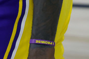 """A detailed view of the """"Lebron James Family Foundation Bracelet"""" and a finger sleeve dedicated to Kobe Bryant worn by LeBron James #23 of the Los Angeles Lakers during the second quarter against the Oklahoma City Thunder at HP Field House at ESPN Wide World Of Sports Complex on August 05, 2020 in Lake Buena Vista, Florida. NOTE TO USER: User expressly acknowledges and agrees that, by downloading and or using this photograph, User is consenting to the terms and conditions of the Getty Images License Agreement."""