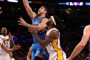 Mitch McGary #33 of the Oklahoma City Thunder shoots over Jordan Hill #27 of the Los Angeles Lakers at Staples Center on March 1, 2015 in Los Angeles, California.   NOTE TO USER: User expressly acknowledges and agrees that, by downloading and or using this photograph, User is consenting to the terms and conditions of the Getty Images License Agreement.
