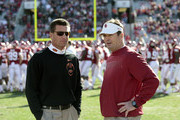(L-R) Head Coach Mike Gundy of the Oklahoma State Cowboys and Head Coach Bob Stoops of the Oklahoma Sooners meet before the game November 24, 2012 at Gaylord Family-Oklahoma Memorial Stadium in Norman, Oklahoma. Oklahoma defeated Oklahoma State 51-48 in overtime.