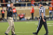 Oklahoma State Cowboys head coach Mike Gundy reacts during game action against the Texas Tech Red Raiders on  November 2, 2013 at AT&T Jones Stadium in Lubbock, Texas. Oklahoma State won the game 52-34.