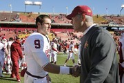 Head coach Paul Rhoads of the Iowa State Cyclones shakes hands with quarterback Trevor Knight #9 of the Oklahoma Sooners at mide field after the Sooners defeated the Cyclones 59-14 at Jack Trice Stadium on November 1, 2014 in Ames, Iowa. The Oklahoma Sooners defeated the Iowa State Cyclones 59-14.