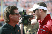 Head coach Mike Gundy of the Oklahoma State Cowboys and head coach Lincoln Riley of the Oklahoma Sooners meet on the field before the game at Boone Pickens Stadium on November 4, 2017 in Stillwater, Oklahoma. Oklahoma defeated Oklahoma State 62-52.