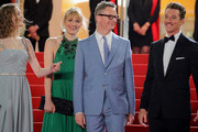 """(L-R) Lola Winding Refn, Liv Corfiven, Nicolas Winding Refn and Miles Teller attend the screening of """"Too Old To Die Young"""" during the 72nd annual Cannes Film Festival on May 17, 2019 in Cannes, France."""