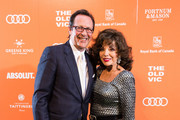 (L-R) Percy Gibson and Joan Collins attends The Old Vic midsummer party at The Brewery on June 23, 2019 in London, England.