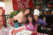 Olivia Culpo hosts a pizza party at Buca di Beppo in support of Best Buddies International on July 31, 2019 in Los Angeles, California.