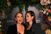 (L-R) Arielle Kebbel, wearing Olivia von Halle, and Torrey DeVitto attend the Olivia von Halle x Disney Maleficent: Mistress of Evil event at The High Line Hotel on October 16, 2019 in New York City.