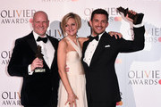 (L to R) Chris Harper, Marianne Elliott and Jonathan Bailey, winners of the Best Musical Revival award, Best Actor In A Supporting Role In A Musical award for 'Company' during The Olivier Awards with Mastercard at the Royal Albert Hall on April 07, 2019 in London, England.