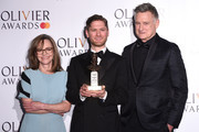 Kyle Soller with the award for Best Actor with presenters Sally Field and Bill Pullman during The Olivier Awards with Mastercard at the Royal Albert Hall on April 07, 2019 in London, England.