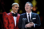 Layton Williams (L) and Shane Richie present an award on stage during The Olivier Awards 2019 with Mastercard at the Royal Albert Hall on April 07, 2019 in London, England.