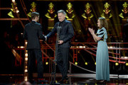 Sally Field (R) and Bill Pullman (C) present Kyle Soller with the Best Actor award for 'The Inheritance', on stage during The Olivier Awards 2019 with Mastercard at the Royal Albert Hall on April 07, 2019 in London, England.