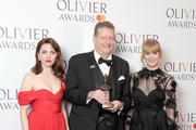 (L to R) Ophelia Lovibond, Howell Binkley, winner of the Best Lighting Design award for 'Hamilton', and Hannah Arterton pose in the press room during The Olivier Awards with Mastercard at Royal Albert Hall on April 8, 2018 in London, England.