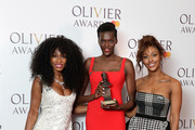 Sheila Atim, (C) winner of the Best Supporting Actress In A Musical award for 'Girl From The North Country', poses with Beverley Knight (L) and Alexandra Burke in the press room during The Olivier Awards with Mastercard at Royal Albert Hall on April 8, 2018 in London, England.