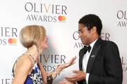 Marianne Elliott, accepting the Best Revival award for 'Angels In America', poses with Alfred Enoch in the press room during The Olivier Awards with Mastercard at Royal Albert Hall on April 8, 2018 in London, England.