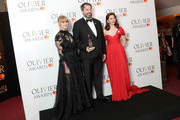 (L to R) Hannah Arterton, Benjamin Pearcy, accepting the Best Set Design award on behalf of Bob Crowley and 59 Productions for 'An American In Paris', pose with Ophelia Lovibond in the press room during The Olivier Awards with Mastercard at Royal Albert Hall on April 8, 2018 in London, England.