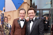 Bryan Cranston (L) and Michael Sheen attend The Olivier Awards with Mastercard at Royal Albert Hall on April 8, 2018 in London, England.